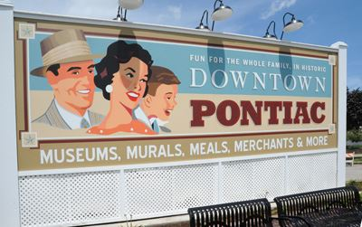 A mural welcoming visitors to downtown Pontiac.