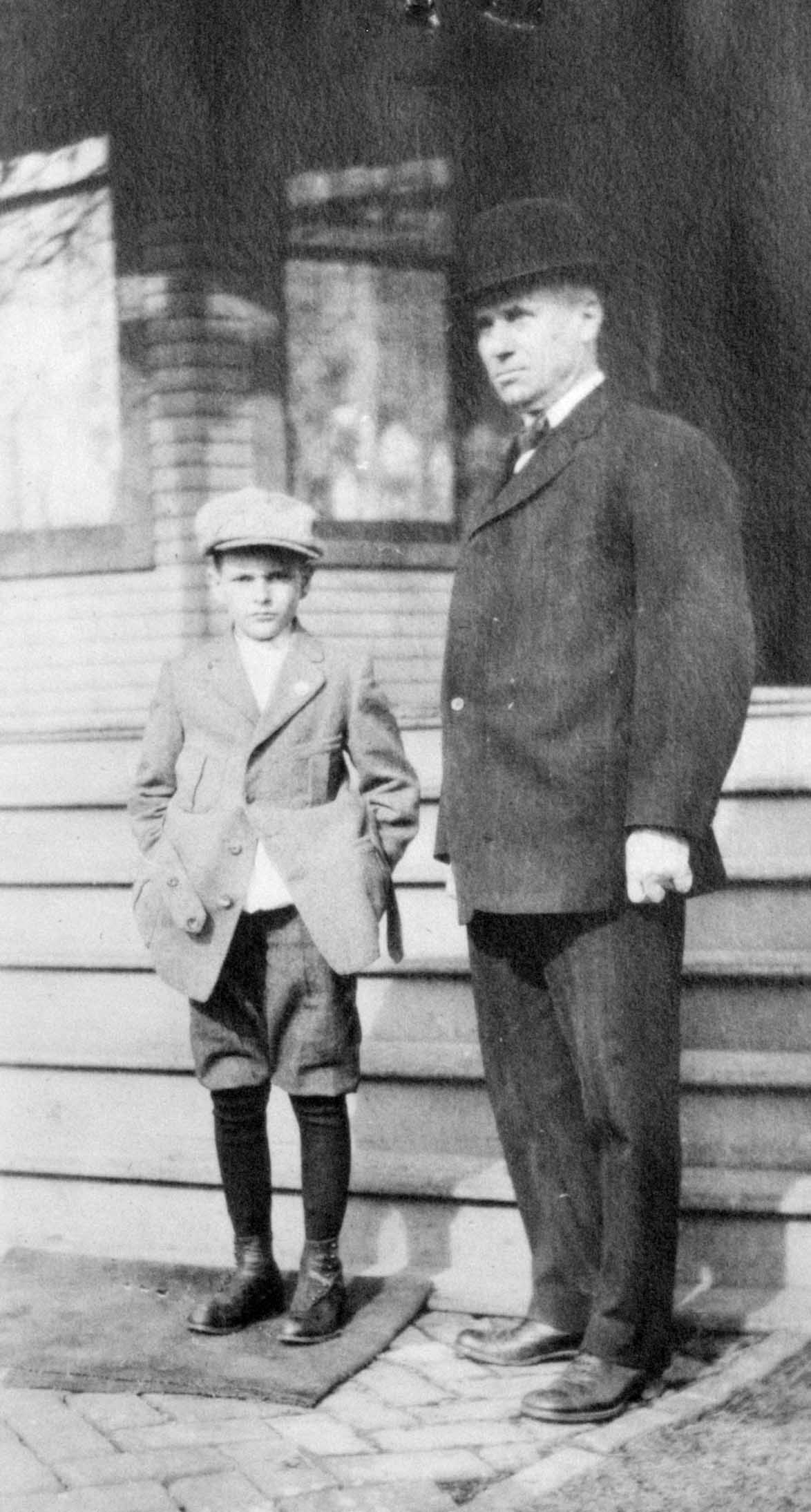 Young boy in short pants with father