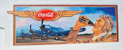 A mural of a World War 2 pilot drinking Coca-Cola in front of planes and the Coca-Cola logo.