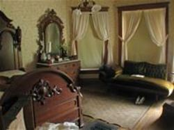 Historic furniture fills one of the Yost House bedrooms.