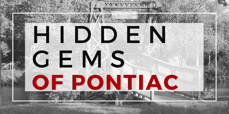Photo of a swinging bridge with text overlay that says hidden gems of Pontiac